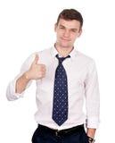 Uomo di affari che gesturing i pollici in su isolati su bianco Immagini Stock