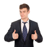 Uomo di affari che gesturing i pollici in su isolati su bianco Fotografia Stock Libera da Diritti