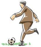 Uomo di affari che gioca gioco del calcio Fotografia Stock