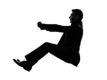 Uomo di affari che guida siluetta Fotografie Stock