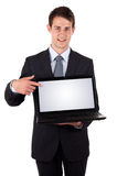 Uomo di affari che indica ad un computer portatile Fotografie Stock Libere da Diritti