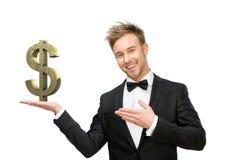 Uomo di affari che indica al simbolo di dollaro immagine stock