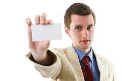 Uomo di affari che mostra il suo spazio in bianco. fotografia stock