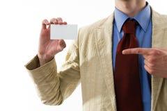 Uomo di affari che mostra il suo spazio in bianco. fotografie stock