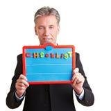 Uomo di affari che mostra lista di controllo Immagini Stock
