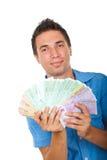 Uomo di affari che mostra manciata di soldi Immagini Stock Libere da Diritti
