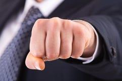 Uomo d'affari che mostra perforazione. Fotografia Stock Libera da Diritti