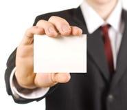Uomo di affari che mostra scheda Fotografie Stock Libere da Diritti