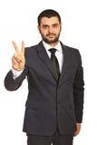 Uomo di affari che mostra vittoria Fotografia Stock