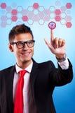 Uomo di affari che opera una scelta Fotografie Stock