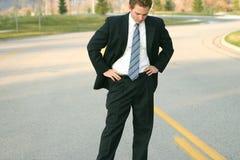 Uomo di affari che osserva giù Fotografia Stock