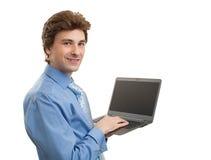 Uomo di affari che per mezzo del computer portatile Fotografie Stock
