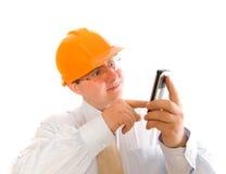 Uomo di affari che per mezzo del telefono mobile Fotografie Stock