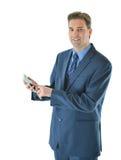 Uomo di affari che per mezzo dello Smart Phone Fotografia Stock Libera da Diritti