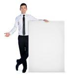 Uomo di affari che presenta qualcosa Fotografia Stock Libera da Diritti