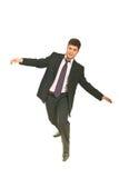 Uomo di affari che prova a mantenere equilibrio Fotografie Stock Libere da Diritti