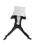 Uomo di affari che salta e che tiene tabellone per le affissioni immagine stock