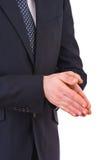 Uomo d'affari che sfrega insieme le sue mani. Fotografia Stock
