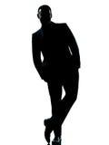 Uomo di affari che si leva in piedi le mani integrali in casella Fotografia Stock Libera da Diritti