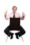 Uomo di affari che si siede su una presidenza Fotografia Stock Libera da Diritti