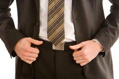 Uomo di affari che tiene il suo rivestimento del vestito immagini stock