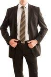 Uomo di affari che tiene il suo rivestimento del vestito fotografie stock libere da diritti