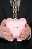 Uomo di affari che tiene la Banca Piggy Fotografia Stock Libera da Diritti