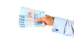 Uomo di affari che tiene Lira turca Immagine Stock