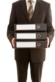 Uomo di affari che tiene tre dispositivi di piegatura Immagine Stock