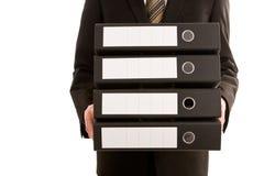 Uomo di affari che tiene tre dispositivi di piegatura Fotografia Stock Libera da Diritti