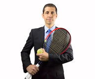 Uomo di affari che tiene un tennis della racchetta Fotografie Stock Libere da Diritti