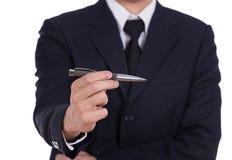 Uomo di affari che tiene una penna Fotografie Stock Libere da Diritti