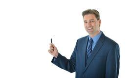 Uomo di affari che tiene una penna Fotografia Stock