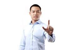 Uomo di affari che tocca uno schermo immaginario Immagini Stock Libere da Diritti