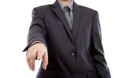 Uomo di affari che tocca uno schermo immaginario contro Immagine Stock Libera da Diritti