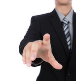 Uomo di affari che tocca uno schermo immaginario contro Fotografia Stock