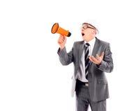 Uomo di affari che urla tramite un megafono Immagine Stock