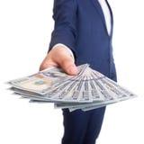 Uomo di affari che visualizza una diffusione del dollaro Fotografia Stock