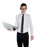 Uomo di affari colpito con il computer portatile Fotografia Stock Libera da Diritti