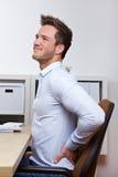 Uomo di affari con dolore alla schiena Immagini Stock Libere da Diritti