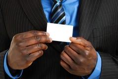 Uomo di affari con il biglietto da visita immagini stock