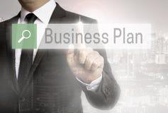 Uomo di affari con il browser del business plan del fondo della città fotografia stock libera da diritti