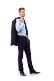 Uomo di affari con il cappotto sulla spalla Fotografie Stock Libere da Diritti