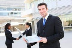 Uomo di affari con il computer portatile Fotografia Stock Libera da Diritti