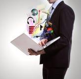 Uomo di affari con il computer portatile. Immagine Stock Libera da Diritti