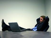 Uomo di affari con il computer portatile 3 immagine stock libera da diritti