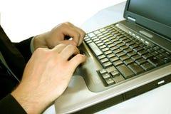 Uomo di affari con il computer portatile 33 Immagine Stock