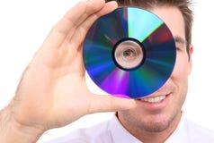 Uomo di affari con il disco di DVD Fotografia Stock