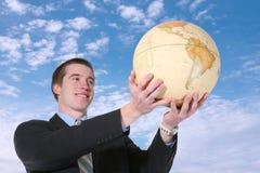 Uomo di affari con il globo Immagini Stock Libere da Diritti