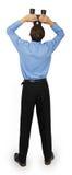 Uomo di affari con il legame blu con cercare del binocolo Immagini Stock